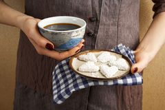Hands holding valentine biscuit and coffee Royalty Free Stock Image