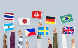 Hands holding various flags isolated Stock Photos
