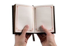 Hands holding a vintage journal Royalty Free Stock Photo