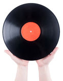 Hands holding vinyl plate Royalty Free Stock Photo
