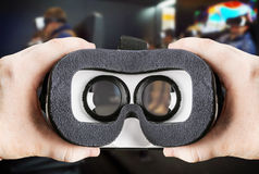 Hands holding virtual glasses Stock Photo