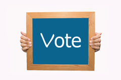 Hands Holding a Vote Sign Royalty Free Stock Photos