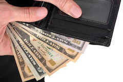 Hands holding wallet with money. Of various value Royalty Free Stock Images