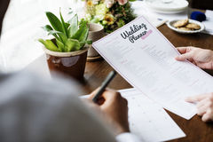 Hands Holding Wedding Planner Checklist Information Preparation Stock Photo