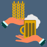 Hands holding wheat ears and beer Royalty Free Stock Images