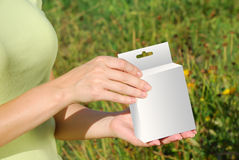 Hands holding a white box Royalty Free Stock Photography