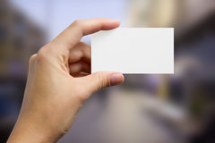 Hands holding a white business visit card, gift Stock Photo