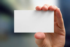 Hands holding a white business visit card, gift Royalty Free Stock Images
