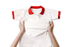 Hands holding a white clean shirt. Hands holding a white clean polo shirt royalty free stock photo