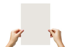 Hands holding a white paper blank isolated on white background Stock Photography