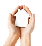 Hands holding white paper house. Real estate and family home concept - closeup picture of female hands holding white blank paper house Stock Photos
