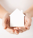 Hands holding white paper house Stock Photography