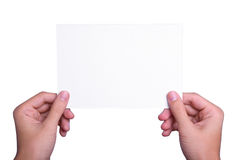 Hands holding white paper sheet Stock Images