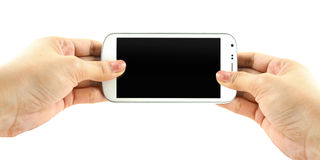 Hands holding white phone isolate on white background. Hands holding white phone isolate on white royalty free stock images