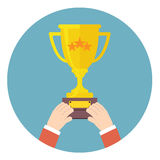 Hands holding winner cup vecto Stock Photo