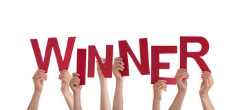 Hands Holding Winner. Many Hands Holding the Red Word Winner, Isolated Royalty Free Stock Photos