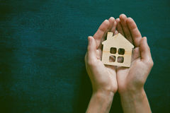 Hands holding wooden house Royalty Free Stock Image