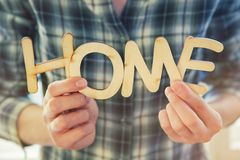 Hands holding wooden letters with word Home Royalty Free Stock Images