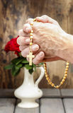 Hands holding wooden rosary Royalty Free Stock Images