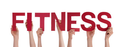 Hands Holding the Word Fitness Stock Images