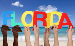 Hands holding the word Florida in summer on beach Stock Photo