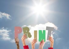 Hands holding word Print against bright sunlight Stock Image