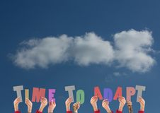 Hands holding word TIME TO ADAPT against sky cloud background. Composite image of hands holding word TIME TO ADAPT against sky cloud background Stock Photos