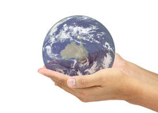 Hands holding world. Elements of this image furnished by NASA Stock Photos