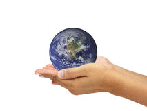 Hands holding world. Elements of this image furnished by NASA Royalty Free Stock Images