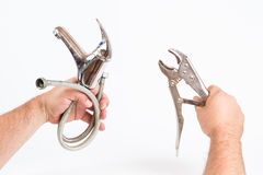 Hands holding wrench and used sink battery Royalty Free Stock Photography