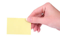 Hands holding a yellow blank notecard. Isolated on white background royalty free stock photos