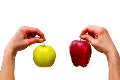 Hands holding a yellow and a red apple Royalty Free Stock Photo