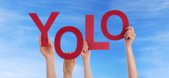Hands Holding Yolo in the Sky Royalty Free Stock Image