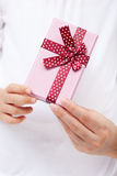 Hands holdng small present Stock Photography