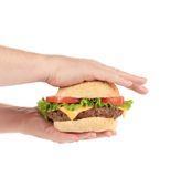 Hands holds big tasty hamburger. Stock Images