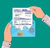 Hands holds envelope with tax declaration Royalty Free Stock Photo