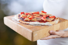 Hands holds homemade pizza Stock Photography