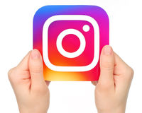 Hands holds Instagram icon on white background. Kiev, Ukraine - January 20, 2016: Hands holds Instagram icon printed on paper. Instagram is an online mobile stock photography