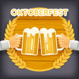 Hands Holds Mug of Beer with Foam Autumn Oktoberfest Celebration Success Prosperity Symbol Icon Wood Background Greeting. Hands Holds Mug of Beer with Foam Stock Photo
