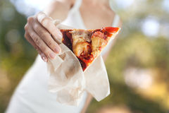 Hands holds piece of homemade pizza Stock Images