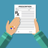 Hands holds a prescription rx form and pills. Stock Photo