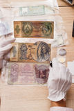 Hands holds a set of old bills in the pockets Royalty Free Stock Photo