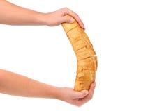 Hands holds sliced long loaf. Royalty Free Stock Images