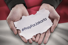 Hands holds text of pray for Jakarta Royalty Free Stock Photo
