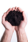 Hands holds topsoil. Man's hands holds topsoil on white background Royalty Free Stock Photos