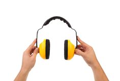 Hands holds working protective headphones. Stock Photos