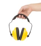 Hands holds working protective headphones. Stock Photo