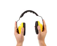 Hands holds working protective headphones. Royalty Free Stock Image