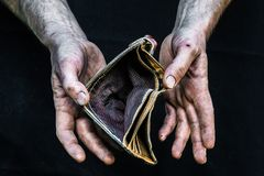 Hands homeless poor man with empty wallet in modern capitalism society. Dirty hands homeless poor man with empty wallet in modern capitalism society royalty free stock photography