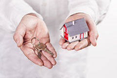 Hands with house and key Stock Images